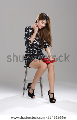 Asian Model in half Sleeves black and white Alphabet Printed Stylish Casual Jumpsuit Rompers with sling red bag.