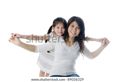 Asian mother having fun time with daughter - stock photo
