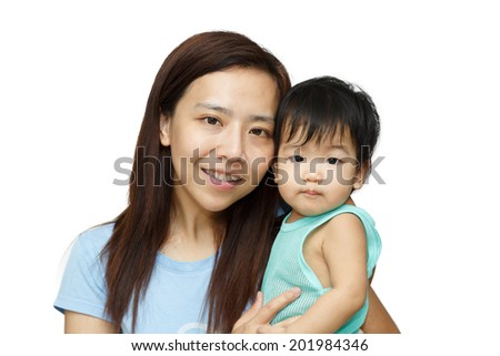 Asian mother smiling with her daughter  - stock photo
