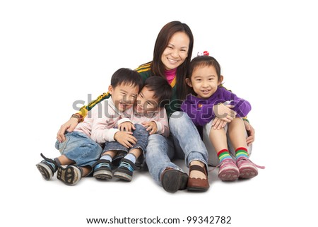 Asian Mother with three kids - stock photo