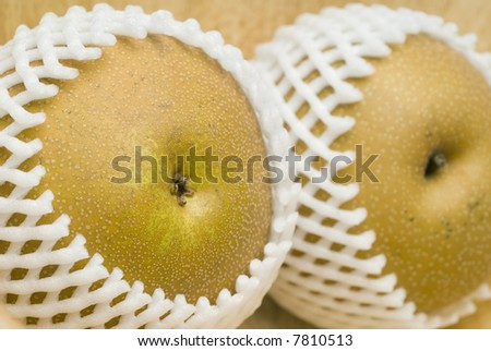 asian nashi pears know as chines japanes oriental sand and apple pears in packing protective net