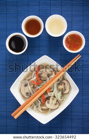Asian noodle soup with mushrooms and vegetables - stock photo