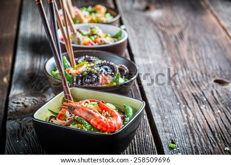 Asian noodles with seafood and vegetables - stock photo