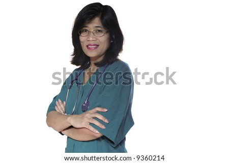 Asian nurse or doctor with scrubs and stethoscope standing with arms crossed - stock photo