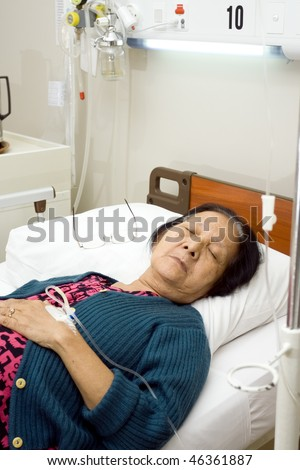 asian old woman bed resting in inpatient treatment at the hospital - stock photo