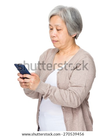 Asian Old woman read message of cellphone - stock photo