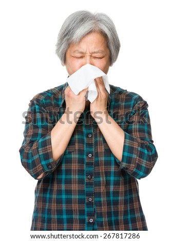 Asian old woman sneeze - stock photo