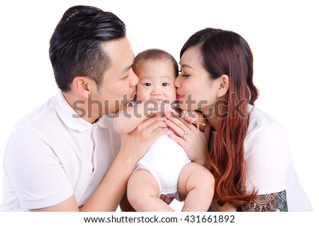 Asian parent kiss their six months old baby boy - stock photo
