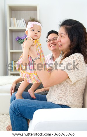 Asian parent playing with their daughter  - stock photo