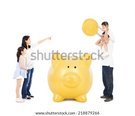 asian parents teaching daughters financial concept with a piggy bank - stock photo