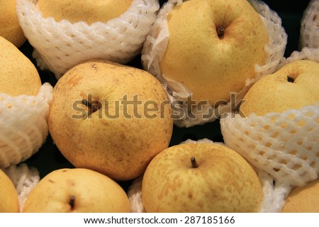 Asian Pears are high in fiber, low in calories and contain micronutrients that are important for blood, bone and cardiovascular health. - stock photo