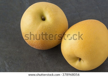 Asian Pears on the slate background - stock photo