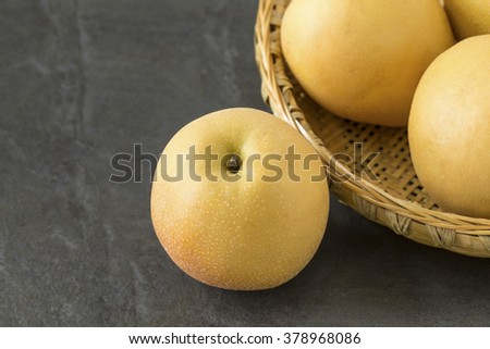 Asian Pears with a bamboo tray on the slate background - stock photo