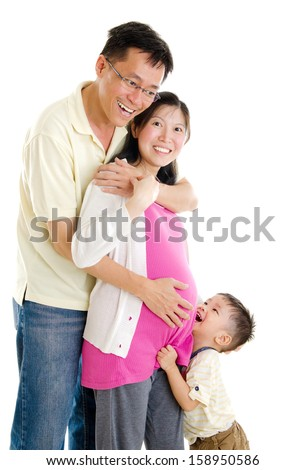 Asian pregnant woman together with her husband and son