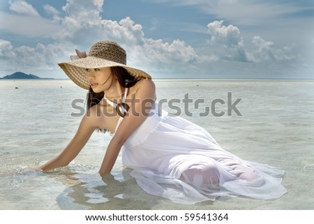 Asian pretty girl during holiday at beautiful ocean