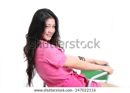 asian pretty girl sitting on white background - stock photo
