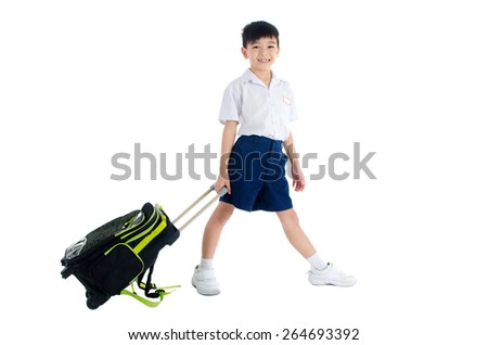 Asian primary school kid with schoolbag - stock photo