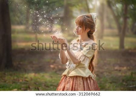 Asian princess with magic in forest. Halloween and Christmas costume. - stock photo
