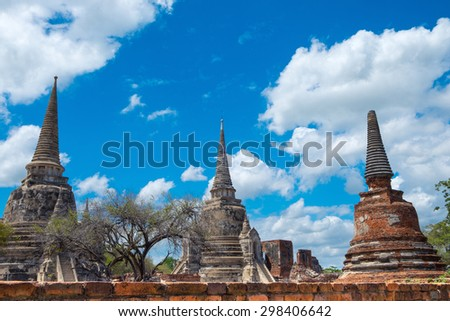 Asian religious architecture. Ancient Buddhist pagoda ruins at Wat Phra Sri Sanphet temple under sky. Ayutthaya, Thailand travel landscape and destinations. - stock photo