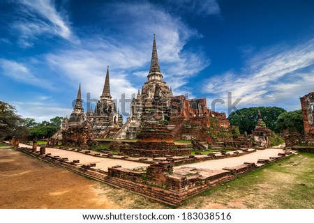 Asian religious architecture. Ancient pagoda at Wat Phra Sri Sanphet temple under blue sky. Ayutthaya, Thailand - stock photo