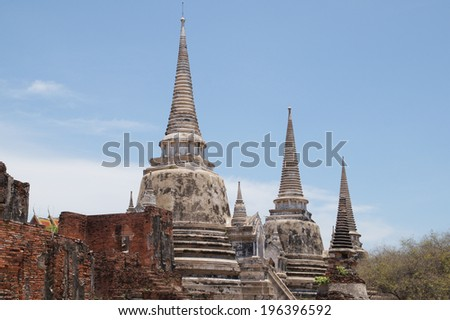 Asian religious architecture. Ancient pagoda at Wat Phra Sri Sanphet temple under blue sky. Ayutthaya, Thailand