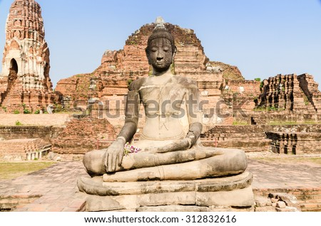 Asian religious architecture. Ancient sandstone sculpture of Buddha at Mahathat temple, Ayutthaya province, Thailand. Unseen Thailand / Historic City of Ayutthaya - stock photo