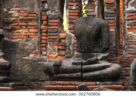 Asian religious architecture. Ancient sandstone sculpture of Buddha at Wat Mahathat temple, Ayutthaya, Thailand. - stock photo