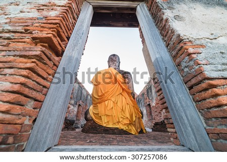 Asian religious architecture. Ancient sandstone sculpture of Buddha at Wat Phra Sri Sanphet temple ruins . Ayutthaya, Thailand travel landscape and destinations - stock photo