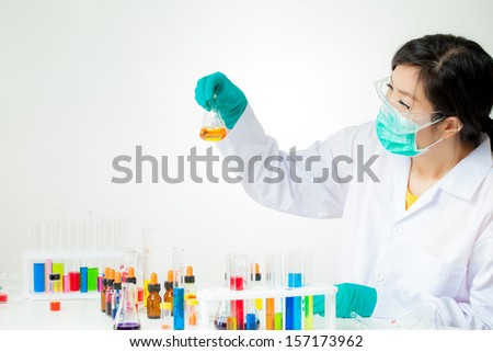 Asian researcher working with chemicals