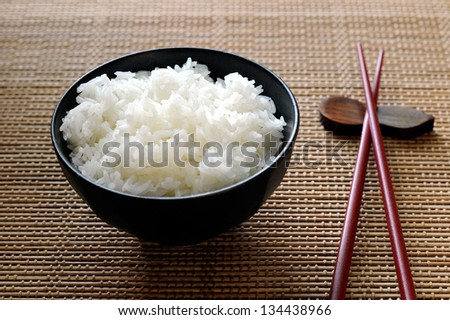 Asian rice bowl and chopstick - stock photo