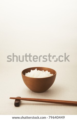 Asian rice bowl and chopstick on the table. - stock photo