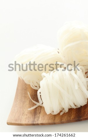 Asian rice noodle, dried Pho on wooden plate