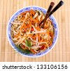 Asian rice noodle with chicken meat and chopsticks, top view - stock photo