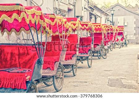 Asian rickshaws in a row - stock photo