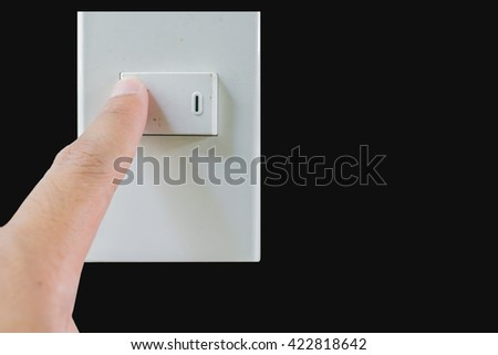 asian's man finger turn off switch isolated on black background, saving power concept. - stock photo