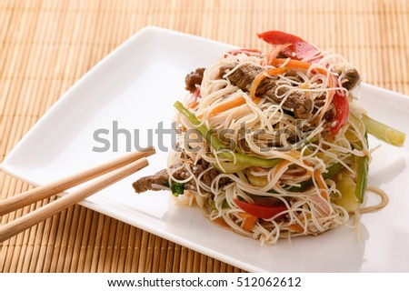 Asian salad with rice noodles, beef and vegetables.