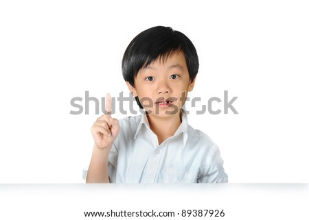 Asian schoolboy raising his index finger to speak - stock photo