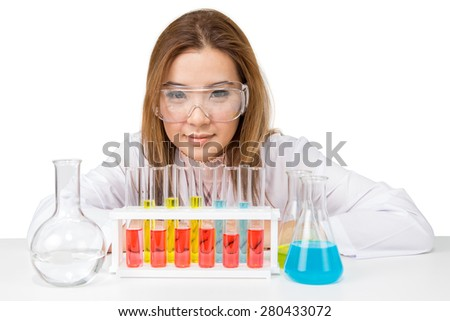 Asian scientific researcher with liquid solution in a laboratory - stock photo