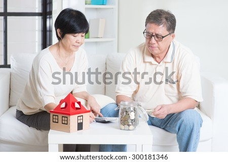 Asian senior couple counting on money. Saving, retirement plan, retirees financial planning concept. Family living lifestyle at home. - stock photo