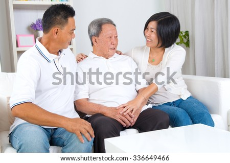Asian senior father with his adult son and daughter at home. Family living lifestyle.