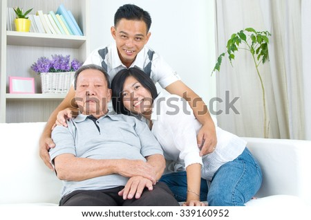 Asian senior father with his adult son and daughter at home. Family living lifestyle. - stock photo