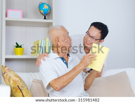 Asian senior man and son