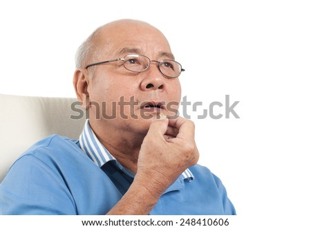 Asian senior man putting pills into mouth. Isolated on white background. - stock photo