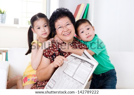 Asian senior woman and grandchildren - stock photo