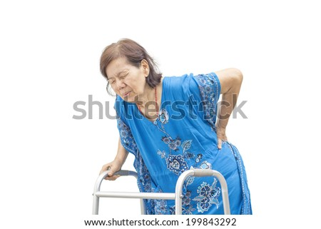 Asian senior woman holding her walker with back pain. - stock photo