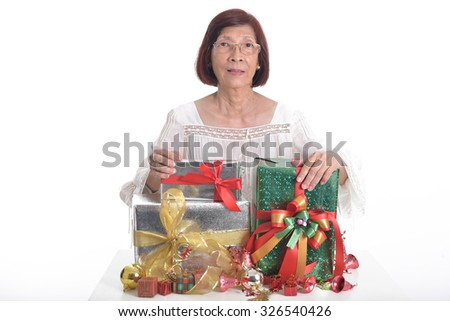 asian senior woman prepare gift on table