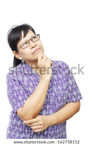 Asian senior woman thinking and holding her chin