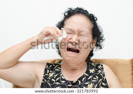 asian senior woman with sadness and crying