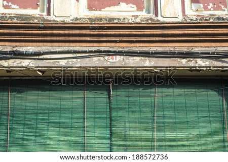 asian shophouse sun blinds - stock photo