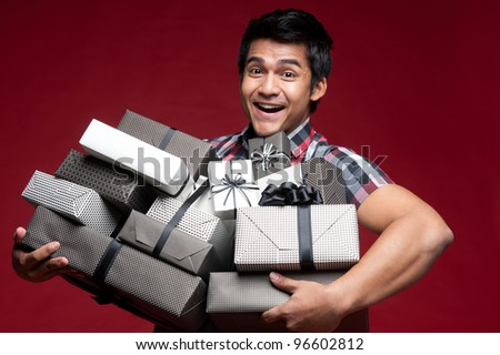 Asian shopping with bags and presents - stock photo